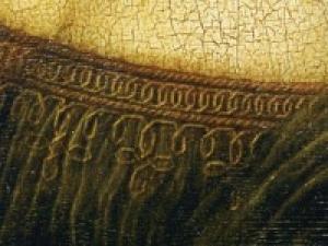 La decoració de l'escotadura del vestit de la Monna Lisa és un detall revelador, segons l'estudiosa Mike Vogt-Luerssen, de la veritable identitat de la dona retratada del quadre, que ella defensa que és Isabel d'Aragó.